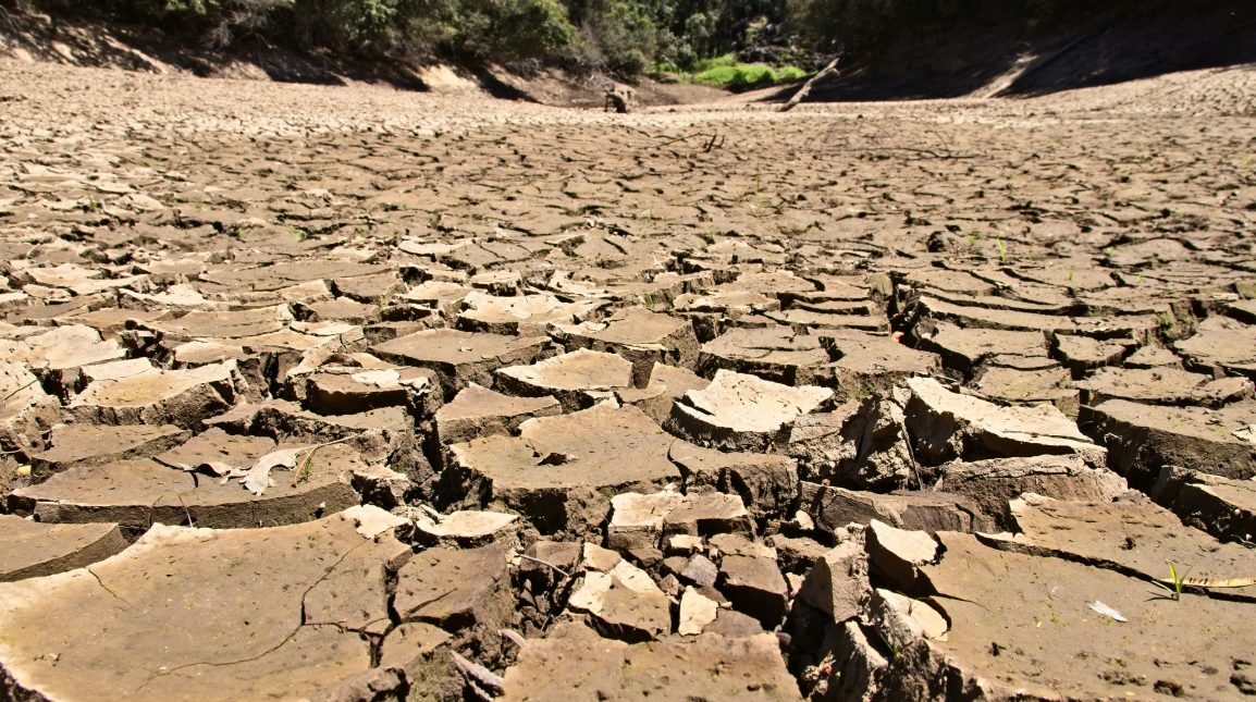 Dry cracked river bed. Drought concept image.